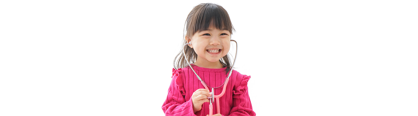 Girl playing with stethoscope at forest park pediatrics